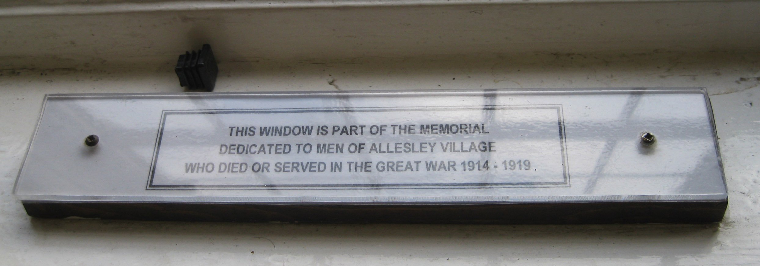 Plaque at Memorial window at Allesley Village Hall